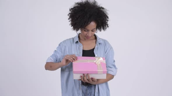 Thumbnail for Young Happy African Woman Opening Gift Box and Looking Surprised