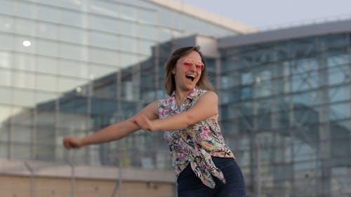 Happy Woman Tourist Dancing Floss Meme Dance Joyfully and Celebrating Success, Enjoying Music