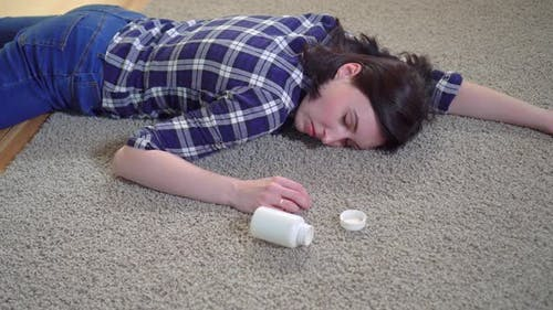 Young Woman Lies Unconscious at Home on the Floor After a Seizure Before Reaching for a Smartphone