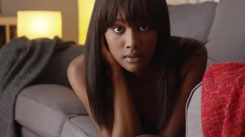 Sexy black woman looking at camera in lingerie