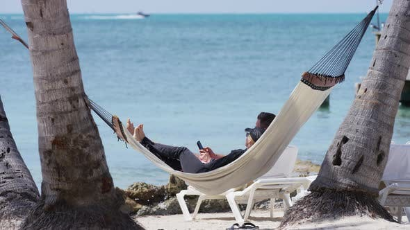 Thumbnail for Relaxing in a hammock on the beach