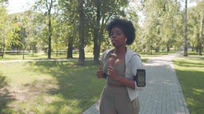 Black Woman Jogging Outdoors