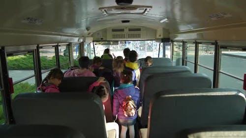 Pupils Leaving School Bus for School
