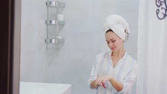 Woman Applying Body Lotion Cream on Hand and Smell Lotion Cream on Hand