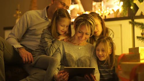 Happy Family Looking Into Tablet