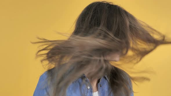 Cover Image for Pretty Woman Shaking Her Head Isolated on Yellow Background