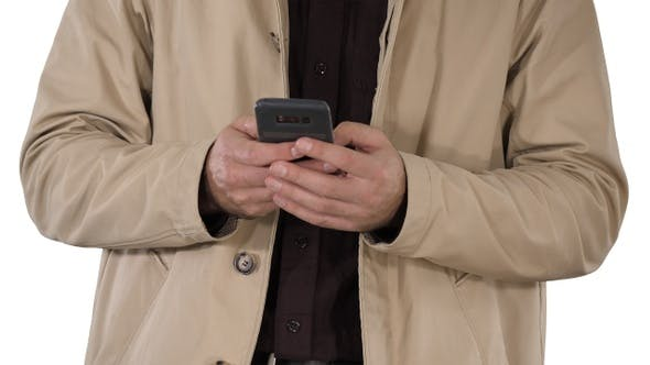 Thumbnail for Man in Trench Coat Using Mobile Smart Phone on White Background