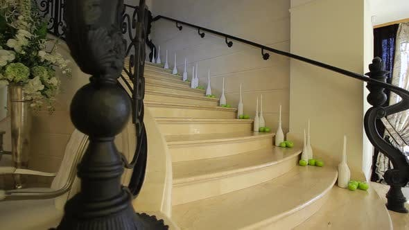 Thumbnail for Stairs of a Modern Building with Decorations Like Apples and Vases in Corners