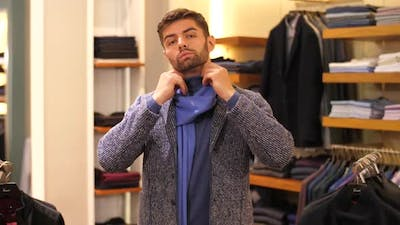 Man Trying on Clothes at Clothing Store