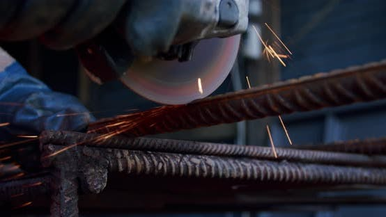 Thumbnail for Close-up Slow Motion. Side View of Male Hands Cutting Metal with Grinding Machine. V2