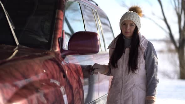 Thumbnail for Young Woman Stands Near a Car in Winter.