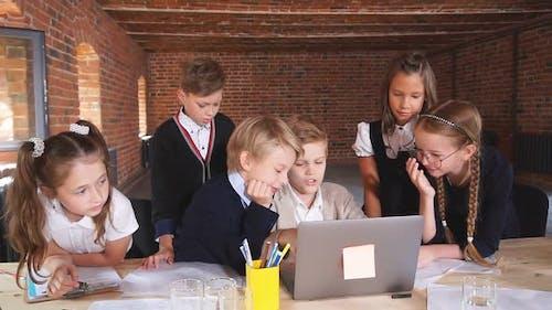 Hardworking Children Using the Laptop