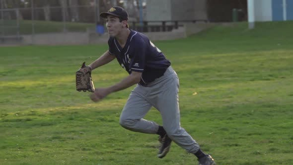 Thumbnail for A young man playing catch with a baseball.