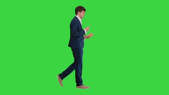 Thumbnail for Businessman Walking and Writing Down His Ideas on a Green Screen, Chroma Key.