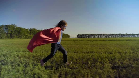 Thumbnail for Little Girl Child In A Field In A Superhero Costume