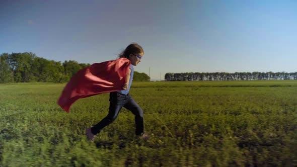 Little Girl Child In A Field In A Superhero Costume