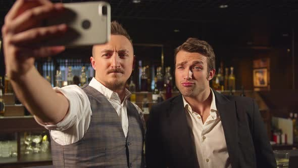 Thumbnail for Two Men Stand at the Bar and Make a Selfie on the Phone