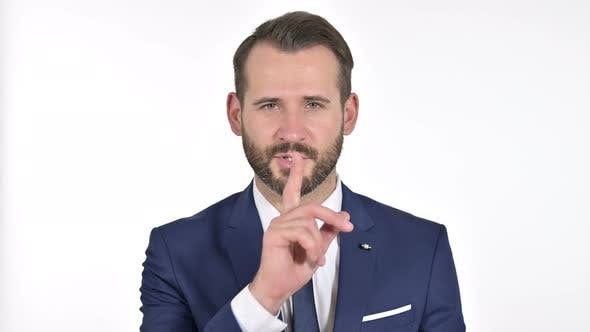 Thumbnail for Businessman Putting Finger on Lips, White Background