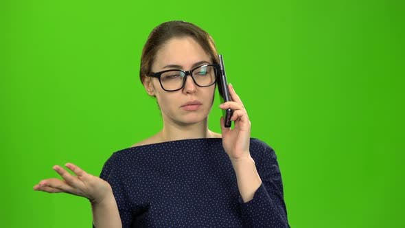 Thumbnail for Businesswoman Speaks on the Phone and Is Angry with the Interlocutor. Green Screen