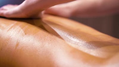 Relaxing Stone Massage on Female Back