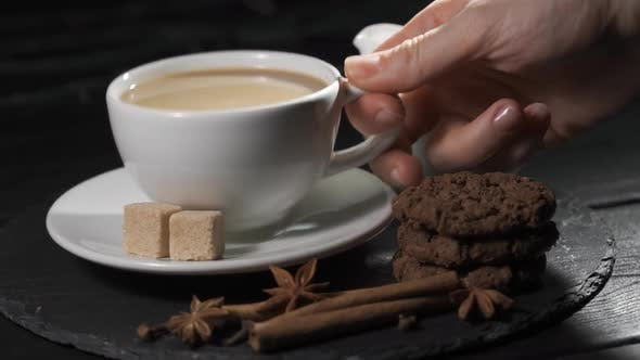 Thumbnail for Female Hands Takes a Cup of Coffee. Woman Warms Her Hands with Hot Coffee Cup