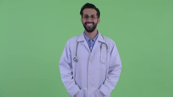 Thumbnail for Happy Young Bearded Persian Man Doctor Smiling