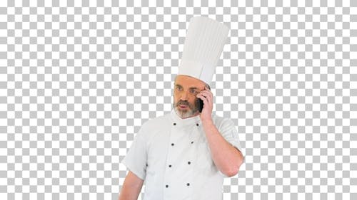 Chef walking and talking on phone, Alpha Channel