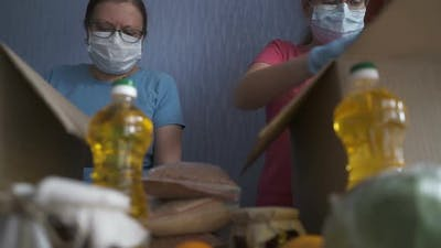 Volunteer in Protective Suits Pack Products.