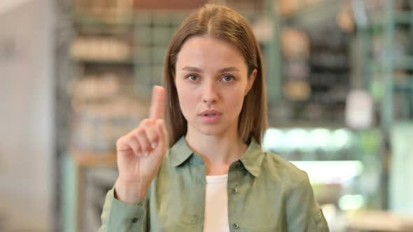 Thumbnail for Portrait of Serious Woman Saying No By Finger Sign