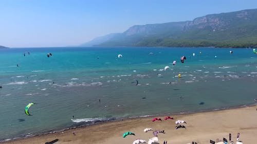 Kiteboarding, Kitesurfing Kiters and Kiteboarders are Pulled Across Sea Water by a Wind Power Kite