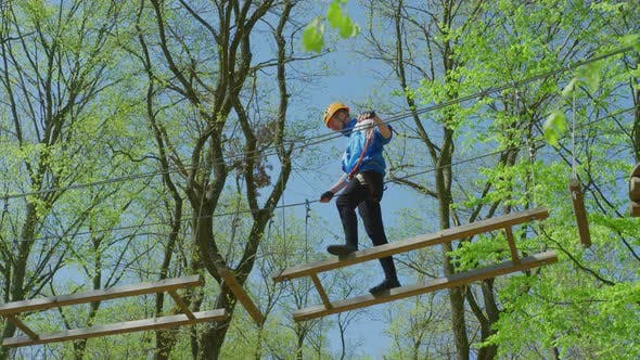 Thumbnail for Man on a rope course