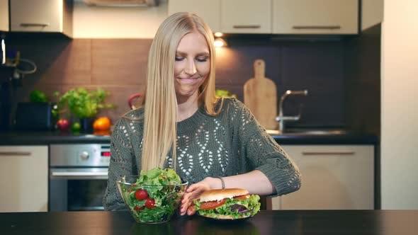 Young Lady Preferring Salad To Hamburger
