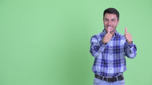 Thumbnail for Happy Young Handsome Hispanic Man Presenting Something