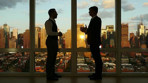 Thumbnail for Two Businessman Having a Business Meeting Talking Together