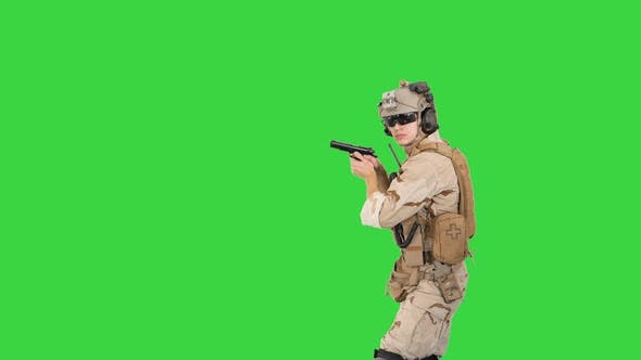 Thumbnail for Soldier Walking Aiming with a Pistol and Shooting To Camera on a Green Screen, Chroma Key.