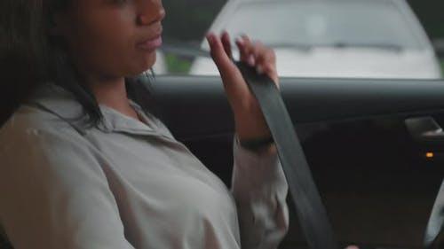 Businesswoman Fastening Seatbelt