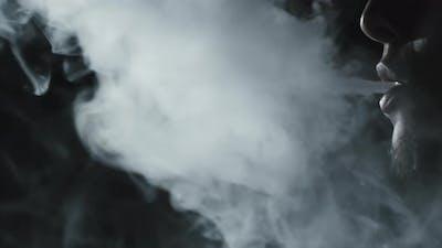 Reverse Shot of Man Vaping