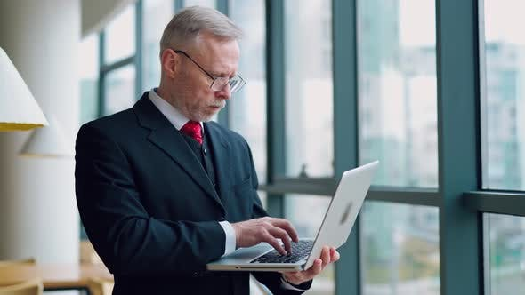 Thumbnail for Serious businessman with laptop