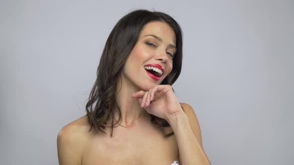 Thumbnail for Beautiful Smiling Young Woman with Red Lipstick