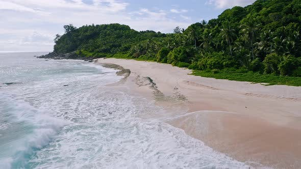 Thumbnail for Aerial Drone Low Altitude Fly Above Tropical Sandy Beach with Ocean Waves at Mahe Island, Seychelles