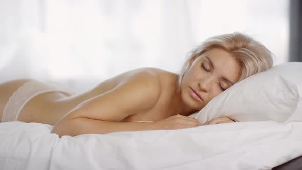 Thumbnail for Young Blonde in Lacy Knickers Sleeping on Bed