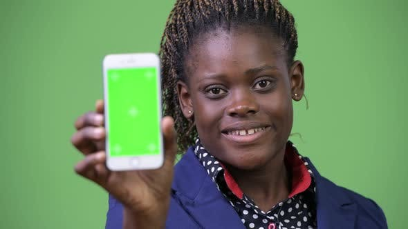Thumbnail for Young Happy African Businesswoman Showing Phone