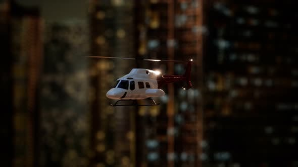 Slow Motion Helicopter Near Skyscrapers at Night