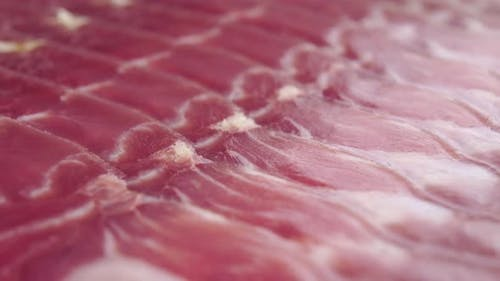 Sliced Iberian jamon in extreme close-up