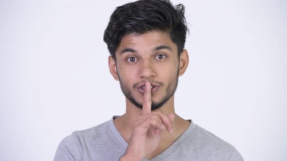 Thumbnail for Young Happy Bearded Indian Man with Finger on Lips