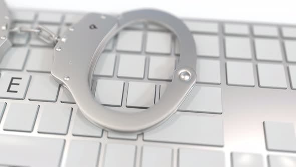 Thumbnail for Handcuffs on Keyboard with ABUSE Text on Keys