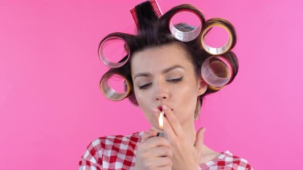 Thumbnail for Woman in Hair Rollers Lighting Cigarette