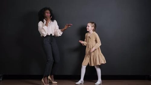 Afroamerican Stepmother and White Adopted Daughter Dance