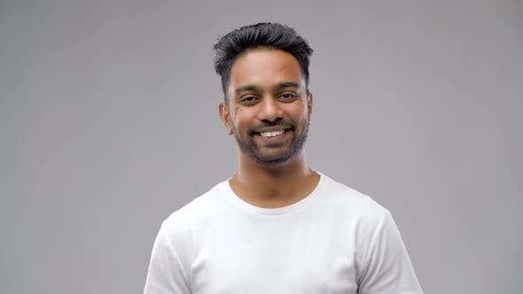 Thumbnail for Young Laughing Indian Man Over Gray Background 14