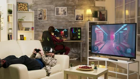 Thumbnail for Man Lying on Sofa Playing Video Games Using Vr Headset